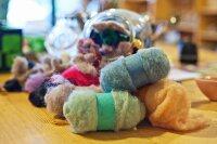 Various balls of felt in craft shop