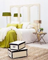 Comfortable green and white bedroom