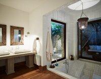 Elegant bathroom with sunken bathtub in modern extension