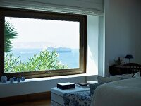 Comfortable seating area in front of window in Mediterranean bedroom with sea view