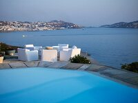 Pool and seating area on terrace above sea with fabulous panoramic view