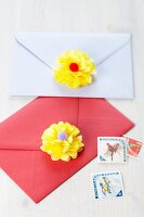 Envelopes decorated with pompom flowers