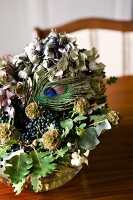 Dried flower arrangement with hydrangea flowers, oak leaves and peacock feather
