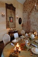 Old, exposed brick masonry in old building as backdrop for long, festively set, Rococo-style table