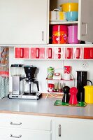 Colourful kitchen utensils in kitchen