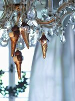 Baubles shaped like ice-cream cones hanging from chandelier