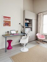 Room corner with serene gray color scheme, splash of color provided by a retro stool under the writing desk and classic swivel chair in front of an office cabinet