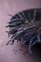Dried lavender flowers in a black bowl
