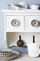 Small cake moulds used as furniture knobs