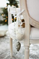 Christmas decorations hanging from Rococo chair