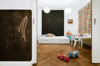 Modern child's bedroom with bed, desk, toys and blackboard