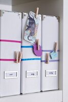 Box files with elastic bands & clothes pegs for holding notes