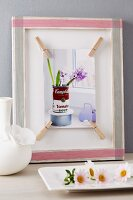 Picture decorated with washi tape and clothes pegs
