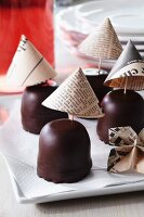 Newspaper cocktail umbrellas decorating chocolate teacakes