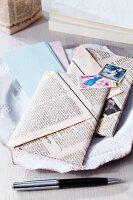 Folded newspaper envelopes