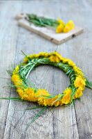 Dandelion wreath on a wooden surface