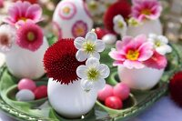 Easter table decoration with pink, red and white spring flowers