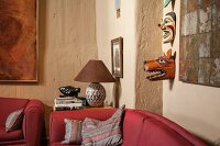 Ethnic masks on rustic wall in corner of living room