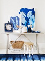 Blue and white ornaments & pictures on table