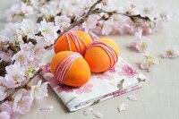 Sprigs of cherry blossom & dyed eggs wrapped with yarn