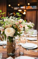 rustic spring wedding table setting with flowers