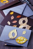 Invitation cards decorated with painted autumn leaves