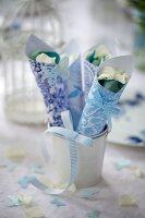 Blue and white patterned paper cones of petals for wedding confetti