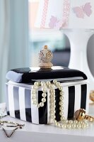 Black and white jewellery box with handle hand-made from stacked wooden beads