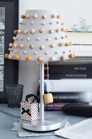 Table lamp with wooden beads decorating lampshade
