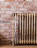 Vintage radiator on brick wall