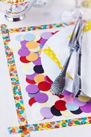 Place mat decorated with washi tape and confetti
