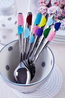 Cutlery with felt confetti stuck on handles