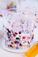 Tealight holder decorated with confetti