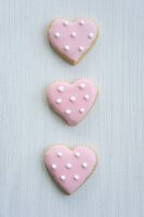 Heart-shaped biscuits with pink icing