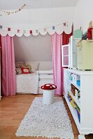 Toadstool chair and cubby bed with curtains, pelmet and bunting in pretty, child's bedroom