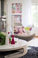Set of pink and white candlesticks on coffee table