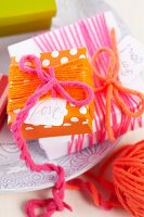 Simple gift box wrapped in colourful woollen yarn