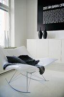 White Stingray rocking chair in corner of modern living room