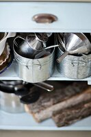Zinc pots on open-fronted shelves