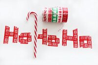 Candy cane and washi tape letters reading 'Ho, ho, ho'