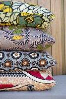 Stack of cushions with ethnic patterns