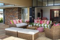 Wicker outdoor furniture on roofed terrace of holiday home