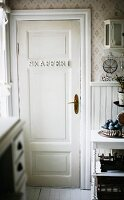 Letters attached to pantry door in rustic interior