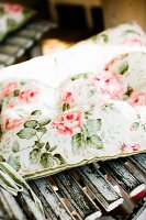 Floral cushion on wooden chair