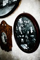 Black and white photos in dark wooden frame on wall