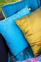 One gold cushion and one blue patterned cushion