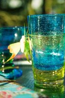 Stacked, colourful drinking glasses
