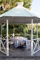 Romantic seating area in gazebo with tent roof