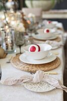Festively set table with Christmas baubles in bowls