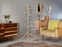 Wooden furniture and stylised wooden Christmas tree in purist, Scandinavian living room
